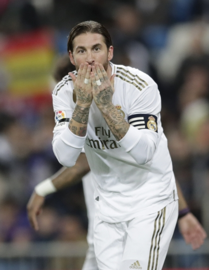 Real Madrid's Sergio Ramos celebrates after scoring his side's third goal, from a penalty kick during a Spanish La Liga soccer match between Real Madrid and Leganes at the Santiago Bernabeu stadium in Madrid, Spain, Wednesday, Oct. 30, 2019. (AP Photo/Bernat Armangue)