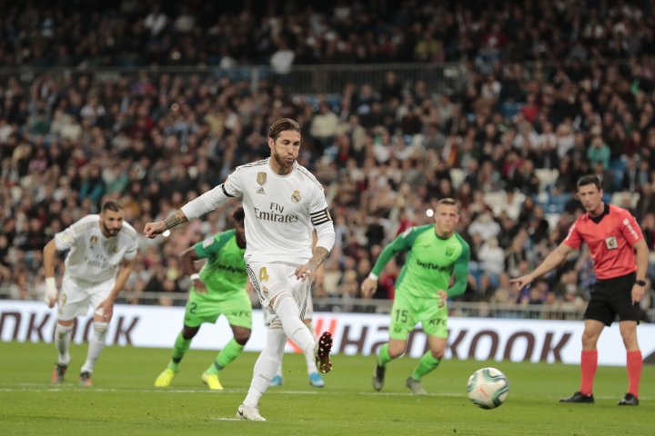 Real Madrid's Sergio Ramos shoots from the penalty spot to score his side's third goal during a Spanish La Liga soccer match between Real Madrid and Leganes at the Santiago Bernabeu stadium in Madrid, Spain, Wednesday, Oct. 30, 2019. (AP Photo/Bernat Armangue)