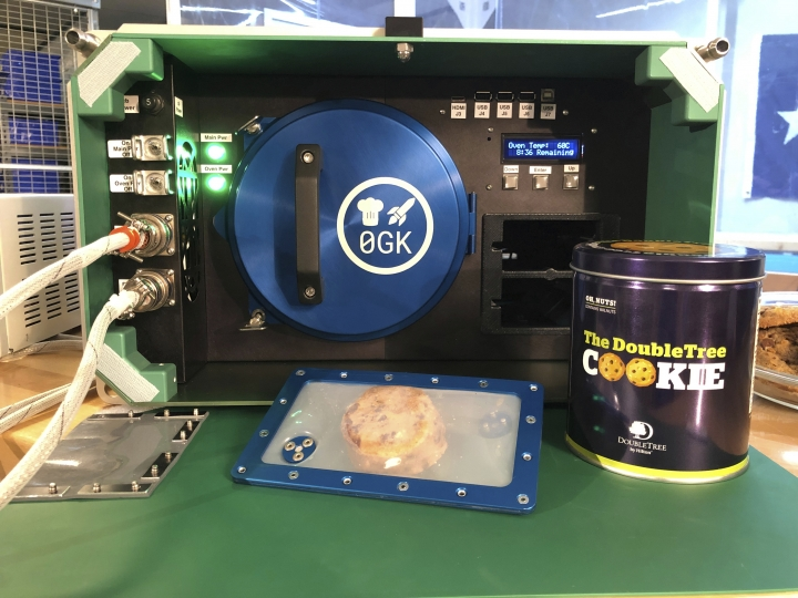 This undated photo made available by Hilton in October 2019 shows a Zero G Kitchen Space Oven. The next delivery of supplies for the International Space Station _ scheduled for liftoff on Saturday, Nov. 1, 2019 _ includes the device. Chocolate chip cookie dough is already up there, waiting to pop into this small electric oven designed for zero gravity. (Hilton via AP)
