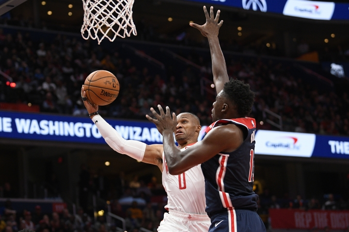 Houston Rockets guard Russell Westbrook (0) goes to the basket against Washington Wizards center Thomas Bryant, right, during the first half of an NBA basketball game, Wednesday, Oct. 30, 2019, in Washington. (AP Photo/Nick Wass)