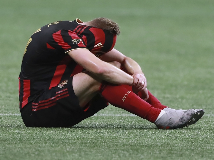 Atlanta United midfielder Julian Gressel reacts to the team's 2-1 loss to Toronto FC in the MLS soccer Eastern Conference final Wednesday, Oct. 30, 2019, in Atlanta. (Curtis Compton/Atlanta Journal-Constitution via AP)