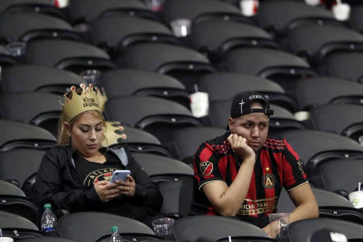 Atlanta United fans remain in their seats after the team lost 2-1 to Toronto FC in the MLS soccer Eastern Conference final Wednesday, Oct. 30, 2019 in Atlanta. (AP Photo/John Bazemore)