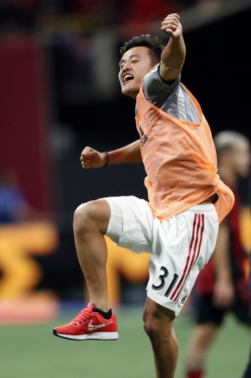 Toronto FC forward Tsubasa Endoh celebrates at the end of the team's MLS soccer Eastern Conference final match against Atlanta United on Wednesday, Oct. 30, 2019 in Atlanta. Toronto won 2-1 and advances to the MLS Cup title game. (AP Photo/John Bazemore)