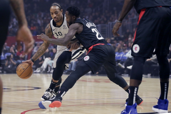 San Antonio Spurs guard DeMar DeRozan (10) drives against Los Angeles Clippers guard Patrick Beverley (21) during the first half of an NBA basketball game in Los Angeles, Thursday, Oct. 31, 2019. (AP Photo/Alex Gallardo)