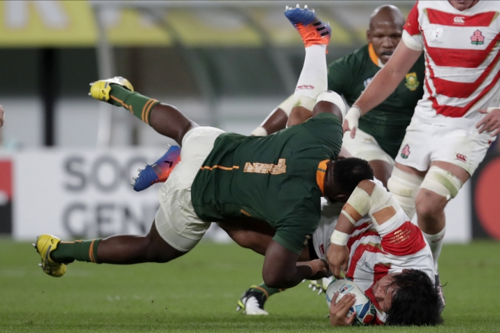 South Africa's Tendai Mtawarira tackles Japan's Keita Inagaki during the Rugby World Cup quarterfinal match at Tokyo Stadium between Japan and South Africa in Tokyo, Japan, Sunday, Oct. 20, 2019. (AP Photo/Jae C. Hong)