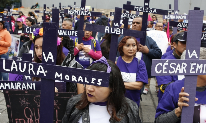 Demonstrators hold crosses with the names of murdered or disappeared women, to demand justice one day after the Day of the Dead holiday in Mexico City, Sunday, Nov. 3, 2019. Nine women are killed per day in Mexico, according to the U.N. (AP Photo/Ginnette Riquelme)