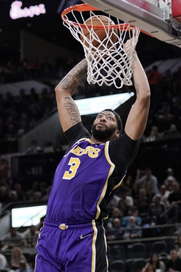 Los Angeles Lakers' Anthony Davis dunks during the first half of an NBA basketball game against the San Antonio Spurs, Sunday, Nov. 3, 2019, in San Antonio. (AP Photo/Darren Abate)