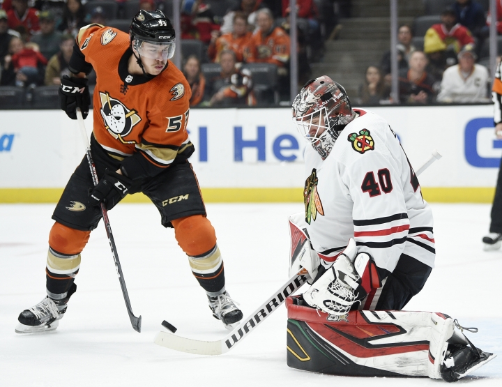 Anaheim Ducks left wing Max Comtois, left, attempts to handle the puck off a save by Chicago Blackhawks goalie Robin Lehner during the second period of an NHL hockey game in Anaheim, Calif., Sunday, Nov. 3, 2019. (AP Photo/Kelvin Kuo)