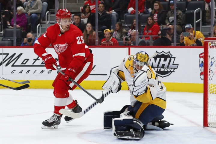 Nashville Predators goaltender Pekka Rinne, right, stops a Detroit Red Wings left wing Brendan Perlini (29) shot in the second period of an NHL hockey game Monday, Nov. 4, 2019, in Detroit. (AP Photo/Paul Sancya)