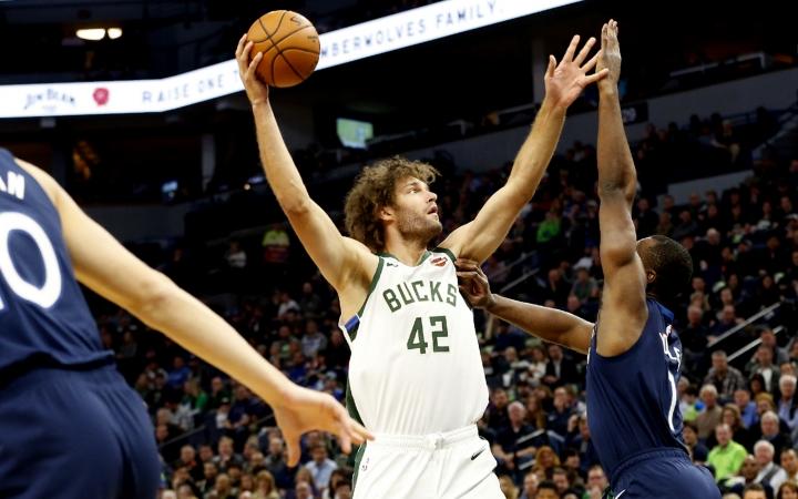 Milwaukee Bucks' Robin Lopez (42) shoots over Minnesota Timberwolves' Noah Vonleh in the first half of an NBA basketball game Monday, Nov 4, 2019, in Minneapolis. (AP Photo/Jim Mone)