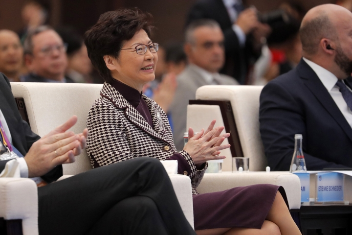 Hong Kong Chief Executive Carrie Lam claps as she attends the second Hongqiao International Economic Forum of the 2nd China International Import Expo at the National Exhibition and Convention Center in Shanghai, China, Tuesday, Nov. 5, 2019. (Wu Hong/Pool Photo via AP)