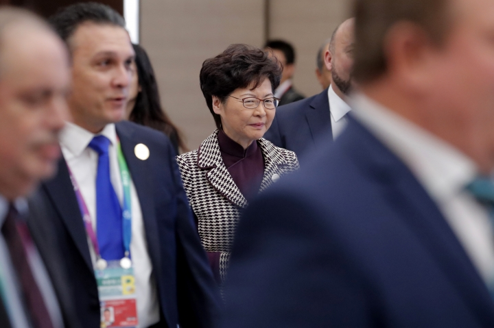 Hong Kong Chief Executive is Carrie Lam, center, arrives for the second Hongqiao International Economic Forum of the 2nd China International Import Expo at the National Exhibition and Convention Center in Shanghai, China, Tuesday, Nov. 5, 2019. (Wu Hong/Pool Photo via AP)