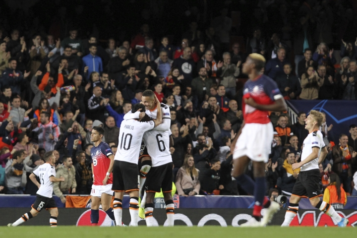 Valencia players celebrate a goal during the Champions League group H soccer match between Valencia and Lille at the Mestalla stadium in Valencia, Spain, Tuesday, Nov. 5, 2019. (AP Photo/Alberto Saiz)