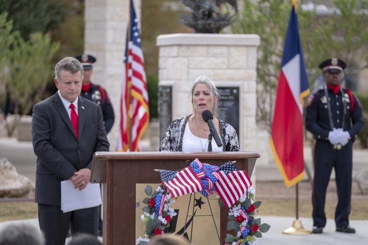 Teena Nemelka, mother of fallen soldier, PFC Aaron Nemelka in the 2009 terrorist attack on Fort Hood delivers an emotional reading at the ten year anniversary of the November 5, 2009 Memorial in Killeen, Texas on Tuesday, Nov. 5, 2019. ( Jeromiah Lizama/The Killeen Daily Herald via AP)