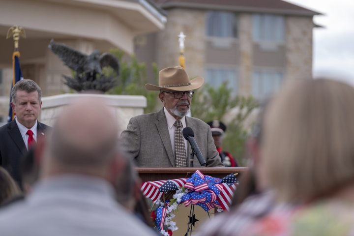 Former mayor of Killeen, CSM (RET) Timothy Hancock remembers the effort of so many involved in erecting the November 5, 2009 Memorial in Killeen and the lives and families it represents at a 10 year anniversary service in Killeen, Texas on Tuesday, Nov. 5, 2019. ( Jeromiah Lizama/The Killeen Daily Herald via AP)