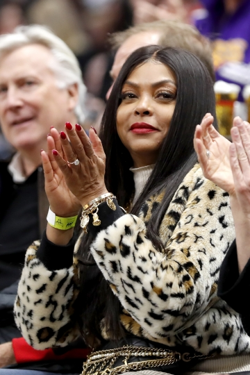 Actress Taraji P. Henson applauds as she sits courtside during the first half of an NBA basketball game between the Chicago Bulls and the Los Angeles Lakers Tuesday, Nov. 5, 2019, in Chicago. (AP Photo/Charles Rex Arbogast)