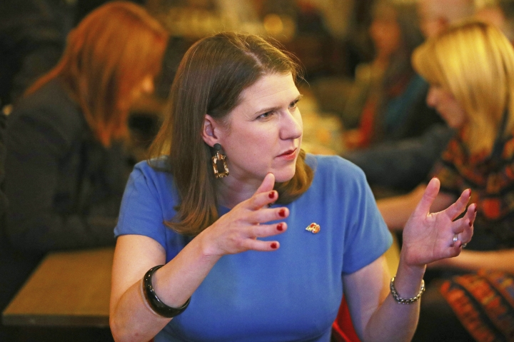 Britain's Liberal Democrat leader Jo Swinson visits a mental health enterprise in North London, Wednesday Nov. 6, 2019. Britain's three major national political parties wooed weary voters on Tuesday, all promising an end to Brexit wrangling if they win next month's national election — but offering starkly different visions of how to achieve that. (Aaron Chown/PA via AP)