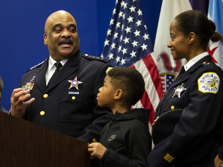 Chicago Police Department Supt. Eddie Johnson looks back at his wife and 10-year-old son as he announces his retirement during a press conference at CPD headquarters, Thursday morning, Nov. 7, 2019. (Ashlee Rezin Garcia/Chicago Sun-Times via AP)