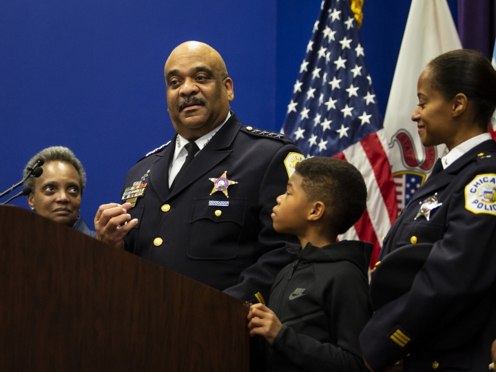 Chicago Police Department Supt. Eddie Johnson, with his 10-year-old son, his wife right, and and Mayor Lori Lightfoot, left, looking on, announces his retirement during a press conference at CPD headquarters, in Chicago, Thursday morning, Nov. 7, 2019. (Ashlee Rezin Garcia/Chicago Sun-Times via AP)