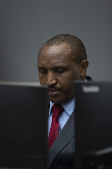 Congolese militia commander Bosco Ntaganda takes his seat in the courtroom of the International Criminal Court, or ICC, to hear the sentence in his trial in The Hague, Netherlands, Thursday, Nov. 7, 2019. The ICC delivered the sentence on Ntaganda, accused of overseeing the slaughter of civilians by his soldiers in the Democratic Republic of Congo in 2002 and 2003. (AP Photo/Peter Dejong, Pool)