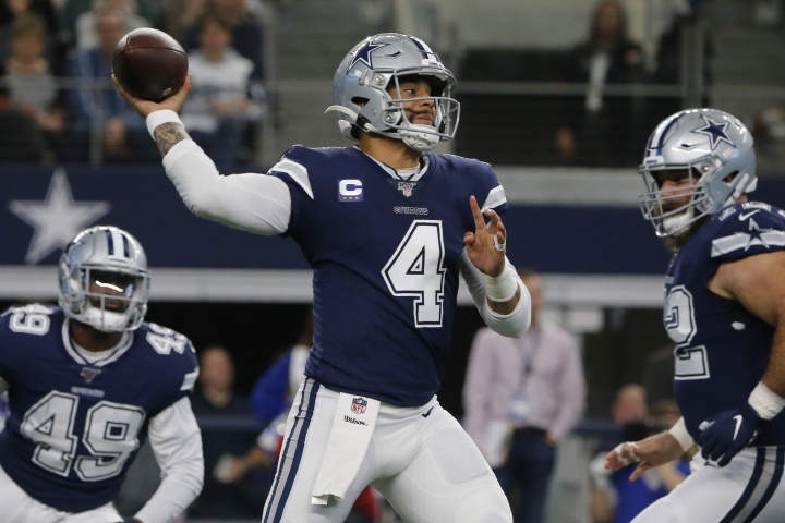 Dallas Cowboys quarterback Dak Prescott (4) throws in the first quarter of an NFL football game against the Los Angeles Rams in Arlington, Texas, Sunday, Dec. 15, 2019. (AP Photo/Michael Ainsworth)