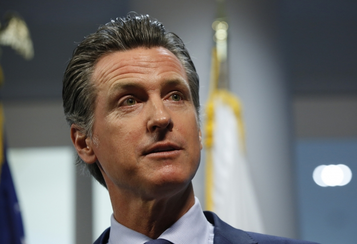 FILE - In this April 12, 2019, file photo, California Gov. Gavin Newsom answers a reporter's question about a report he presented concerning the worsening wildfires in the state, during a news conference, in Rancho Cordova, Calif. Newsom has rejected a $13.5 billion settlement that Pacific Gas & Electric struck just last week with thousands of people who lost homes, businesses and family members in a series of devastating fires that drove the nation's largest utility into bankruptcy. (AP Photo/Rich Pedroncelli, File)