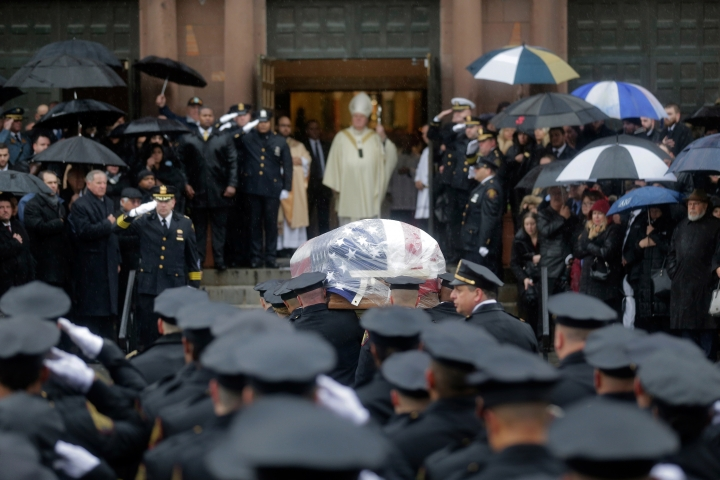 Pallbearers transport the casket of Jersey City Police Detective Joseph Seals in to St. Aeden's church for the funeral services in Jersey City, N.J., Tuesday, Dec. 17, 2019. The 40-year-old married father of five was killed in a confrontation a week ago with two attackers who then drove to a kosher market and killed three people inside before dying in a lengthy shootout with police. (AP Photo/Seth Wenig)