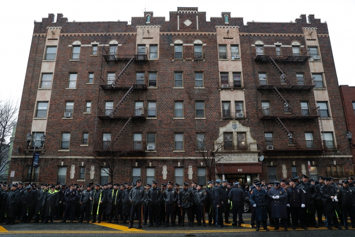 Police officers and other first responders gather before the funeral of Jersey City Police Detective Joseph Seals in Jersey City, N.J., Tuesday, Dec. 17, 2019. Funeral services for Seals are scheduled for Tuesday morning. The 40-year-old married father of five was killed in a confrontation a week ago with two attackers who then drove to a kosher market and killed three people inside before dying in a lengthy shootout with police. (AP Photo/Seth Wenig)