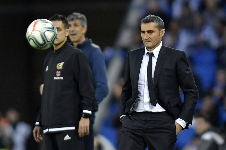 Barcelona's head coach Ernesto Valverde, right, stands on the touchline during the Spanish La Liga soccer match between Real Sociedad and Barcelona, at Anoeta stadium, in San Sebastian, Spain, Saturday, Dec. 14, 2019. (AP Photo/Alvaro Barrientos)