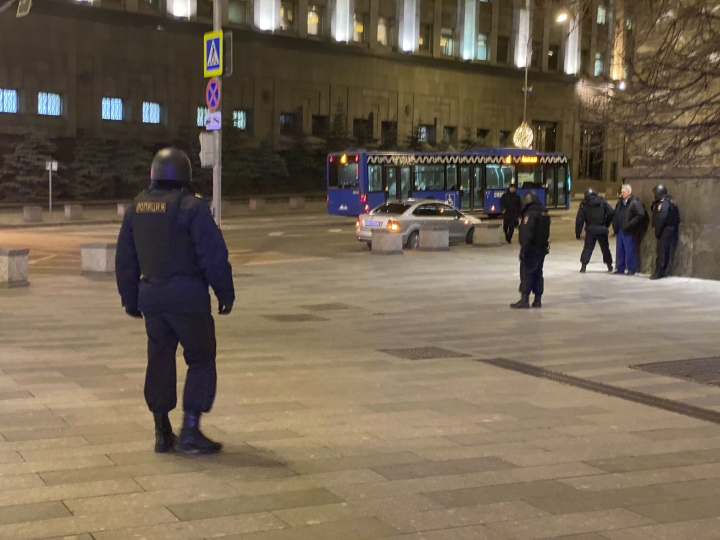 Russian police officers secure the area near the building of the Federal Security Service (FSB, Soviet KGB successor) in the background in Moscow, Russia, Thursday, Dec. 19, 2019. Russia's main security agency says shots have been fired near its headquarters in downtown Moscow. (AP Photo/Ilya Varlamov)