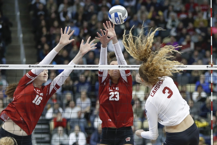 Stanford's Holly Campbell (3) tries to spike through the block efforts of Wisconsin's Dana Rettke (16) and Molly Haggerty (23) during the NCAA Division I women's volleyball championship match, Saturday, Dec. 21, 2019, in Pittsburgh. (AP Photo/Keith Srakocic)