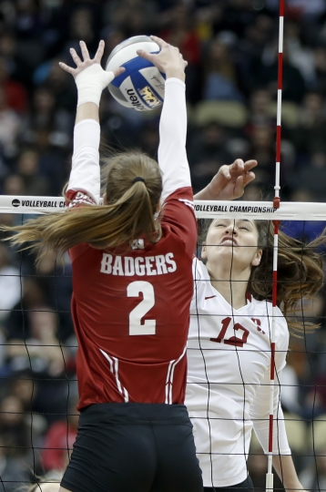 Wisconsin's Sidney Hilley (2) blocks a spike by Stanford's Audriana Fitzmorris (12) during the NCAA Division I women's volleyball championship match, Saturday, Dec. 21, 2019, in Pittsburgh. (AP Photo/Keith Srakocic)