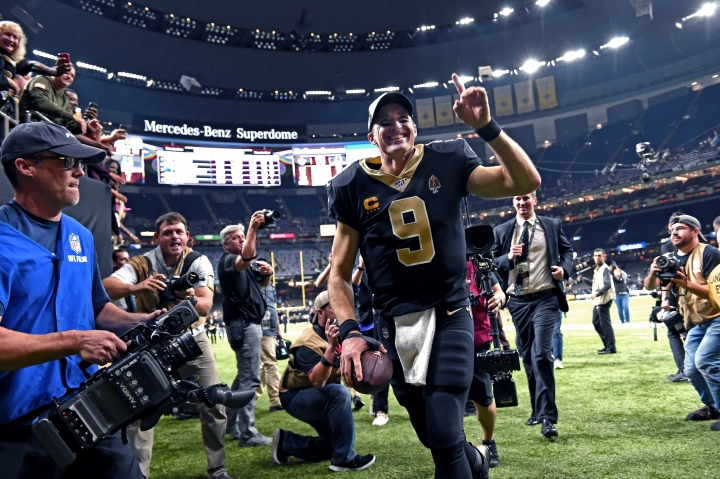 New Orleans Saints quarterback Drew Brees (9) runs off the field after defeating the Indianapolis Colts 34-7 in an NFL football game in New Orleans, Monday, Dec. 16, 2019. Brees broke the NFL record for career touchdown passes, surpassing Peyton Manning, and the all-time single game completion percentage as well. (AP Photo/Bill Feig)