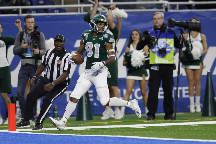Eastern Michigan wide receiver Quian Williams looks back after a 50-yard touchdown during the first half of the Quick Lane Bowl NCAA college football game against Pittsburgh, Thursday, Dec. 26, 2019, in Detroit. (AP Photo/Carlos Osorio)
