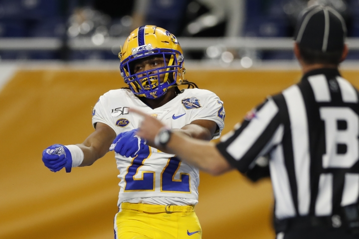 Pittsburgh running back Vincent Davis (22) reacts after an 8-yard run for a touchdown against Eastern Michigan during the first half of the Quick Lane Bowl NCAA college football game, Thursday, Dec. 26, 2019, in Detroit. (AP Photo/Carlos Osorio)