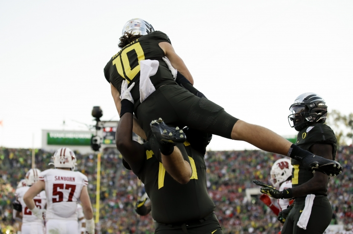 Oregon quarterback Justin Herbert celebrates after scoring against Wisconsin during first half of the Rose Bowl NCAA college football game Wednesday, Jan. 1, 2020, in Pasadena, Calif. (AP Photo/Marcio Jose Sanchez)