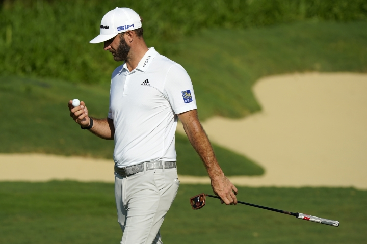 Dustin Johnson looks at his ball after missing his birdie putt on the 17th green during first round of the Tournament of Champions golf event, Thursday, Jan. 2, 2020, at Kapalua Plantation Course in Kapalua, Hawaii. (AP Photo/Matt York)
