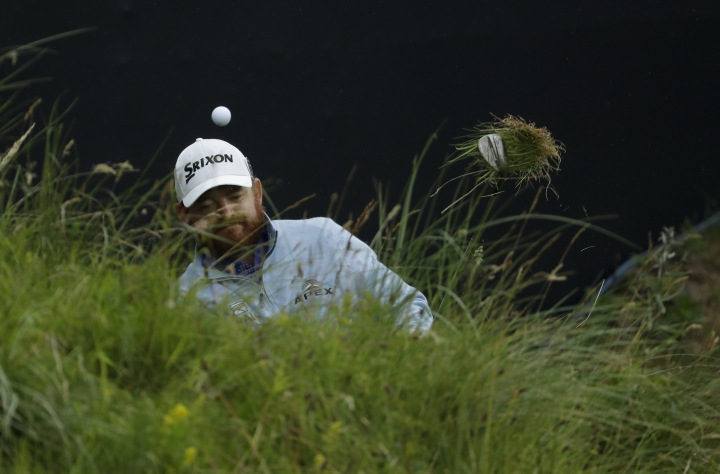 FILE - In this July 21, 2019, file photo, J.B. Holmes, of the United States, chips out onto the 18th green during the final round of the British Open Golf Championships in Portrush, Northern Ireland. Holmes shot 87 and said it took him a long time to recover. (AP Photo/Matt Dunham, File)