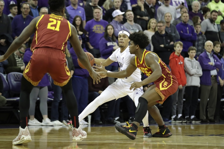 Washington guard Quade Green, center, looks to pass between Southern California guard Ethan Anderson, right, and forward Onyeka Okongwu (21) during the first half of an NCAA college basketball game, Sunday, Jan. 5, 2020, in Seattle. (AP Photo/Ted S. Warren)