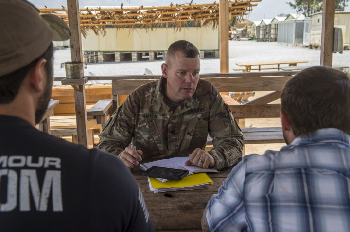 In this photo taken Feb. 24, 2018 and released by the U.S. Air Force, U.S. Army Lt. Col. Todd Martin, safety officer assigned to the Combined Joint Task Force - Horn of Africa (CJTF-HOA) Safety directorate, speaks with CJTF-HOA personnel assigned to Camp Simba, Manda Bay, Kenya, about safety concerns during a battlefield circulation site visit at Camp Simba in Manda Bay, Kenya. The al-Shabab extremist group said Sunday, Jan. 5, 2020 that it has attacked the Camp Simba military base used by U.S. and Kenyan troops in coastal Kenya, while Kenya's military says the attempted pre-dawn breach was repulsed and at least four attackers were killed. (Staff Sgt. Timothy Moore/U.S. Air Force via AP)