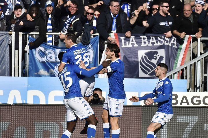 Brescia forward Mario Balotelli, left, is embraced by teammate Romulo after scoring his side's first goal during the Italian Series A soccer match between Brescia and Lazio at the Mario Rigamonti stadium in Brescia, Italy, Sunday, Jan. 5, 2020. (Gianluca Checchi/LaPresse via AP)