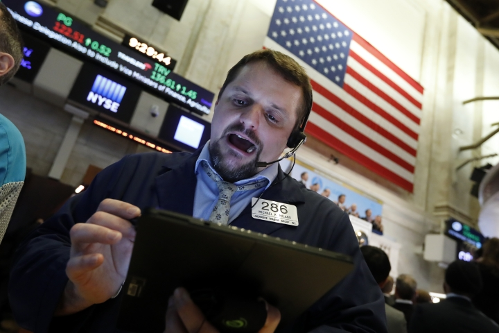 Trader Michael Milano works on the floor of the New York Stock Exchange, Thursday, Jan. 9, 2020. Stocks are opening broadly higher on Wall Street as traders welcome news that China's top trade official will head to Washington next week to sign a preliminary trade deal with the U.S. (AP Photo/Richard Drew)