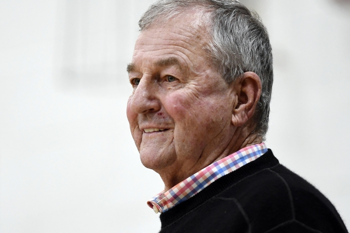 Saint Joseph coach Jim Calhoun smiles during the first half of the team's NCAA college basketball game against Pratt Institute, Friday, Jan. 10, 2020, in West Hartford, Conn. Now coaching Division III basketball with the same fire he stalked the sidelines at UConn, Calhoun is reaching his 900th win as a college coach. (AP Photo/Jessica Hill)