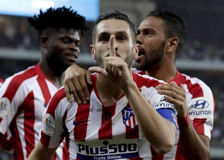 Atletico Madrid's Koke celebrates his goal with teammates during the Spanish Super Cup semifinal soccer match between Barcelona and Atletico Madrid at King Abdullah stadium in Jiddah, Saudi Arabia, Thursday, Jan. 9, 2020. (AP Photo/Hassan Ammar)