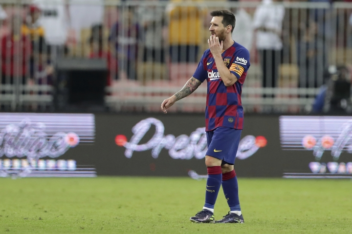 Barcelona's Lionel Messi walks in dejection end of the Spanish Super Cup semifinal soccer match between Barcelona and Atletico Madrid at King Abdullah stadium in Jiddah, Saudi Arabia, Thursday, Jan. 9, 2020. (AP Photo/Hassan Ammar)