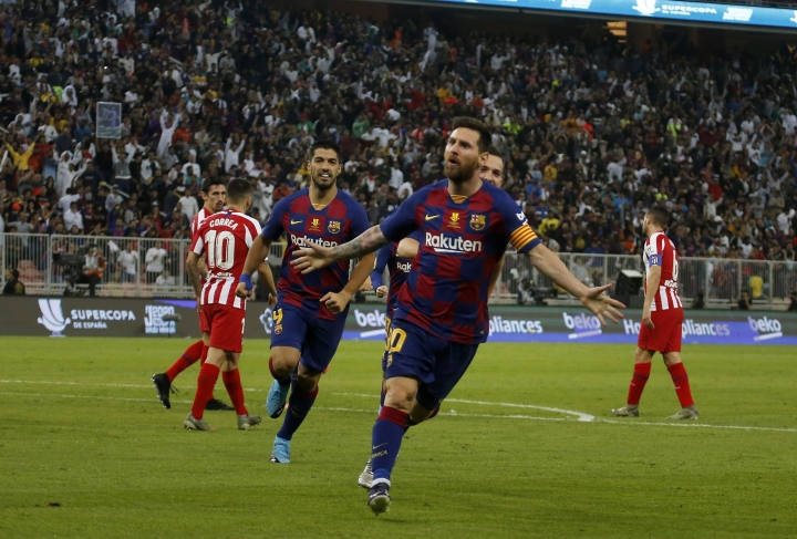 Barcelona's Lionel Messi celebrates after scoring his side first goal during the Spanish Super Cup semifinal soccer match between Barcelona and Atletico Madrid at King Abdullah stadium in Jiddah, Saudi Arabia, Friday, Jan. 10, 2020. (AP Photo/Amr Nabil)