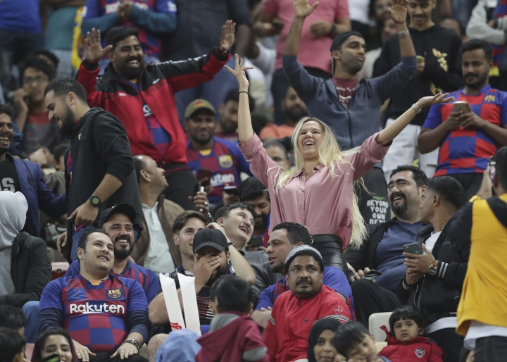 A woman dances in the stands in half time of the Spanish Super Cup semifinal soccer match between Barcelona and Atletico Madrid at King Abdullah stadium in Jiddah, Saudi Arabia, Thursday, Jan. 9, 2020. (AP Photo/Hassan Ammar)