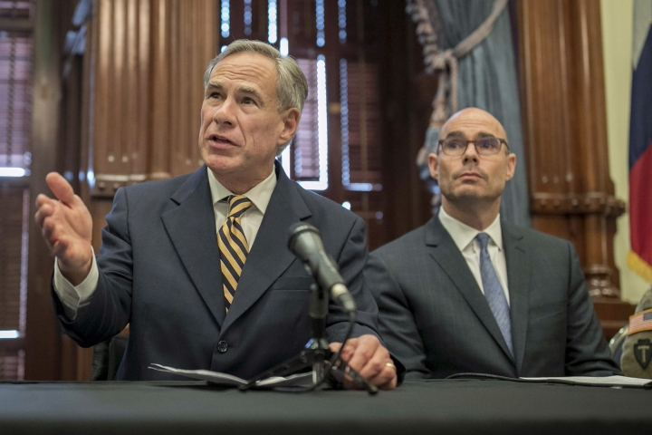 "FILE - In this June 21, 2019 file photo, Gov. Greg Abbott, left, speaks at a news conference at the Capitol, in Austin, Texas. Abbott says the state will reject the re-settlement of new refugees, becoming the first state known to do so under a recent Trump administration order. In a letter released Friday, Jan, 10, 2020, Abbott wrote that Texas ""has been left by Congress to deal with disproportionate migration issues resulting from a broken federal immigration system."" He added that Texas, which typically takes in thousands of refugees each year, has done ""more than its share."" Governors in 42 other states have said they will consent to allowing in more refugees, according to the Lutheran Immigration and Refugee Service.(Jay Janner/Austin American-Statesman via AP, File)"