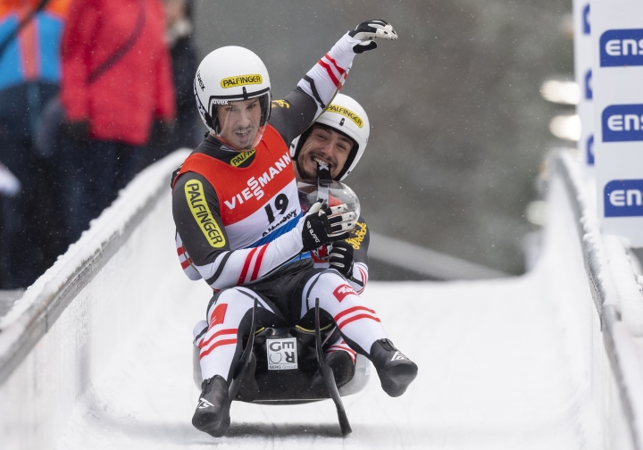 Austria's Thomas Steu, left, and Lorenz Koller, right, celebrate winning the men's doubles luge race of the Luge World Cup in Altenberg, Germany, Saturday, Jan. 11, 2020. (Matthias Rietschel/dpa via AP)
