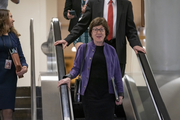 Sen. Susan Collins, R-Maine, center, a member of the Senate Intelligence Committee, heads to a briefing by Secretary of State Mike Pompeo, Defense Secretary Mark Esper, and other national security officials on the details of the threat that prompted the U.S. to kill Iranian Gen. Qassem Soleimani in Iraq, Wednesday, Jan. 8, 2020 on Capitol Hill in Washington. (AP Photo/J. Scott Applewhite)